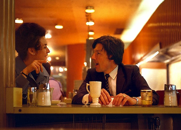 people talking at cafe in 1970