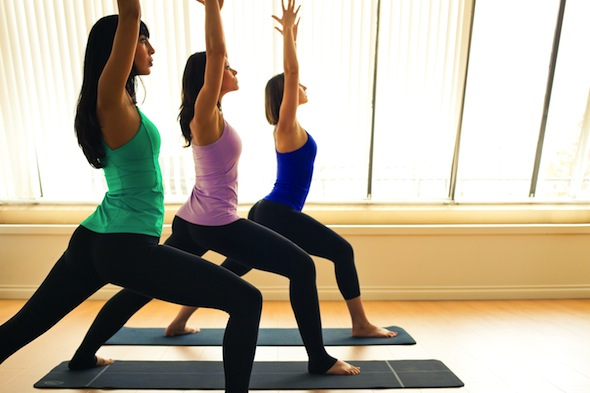 women yoga exercise in tights