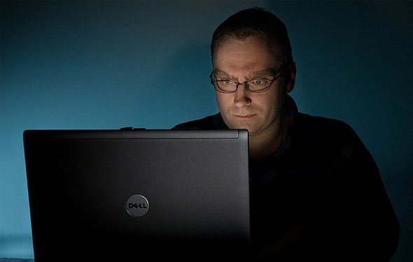 freelance laptop guy in the dark