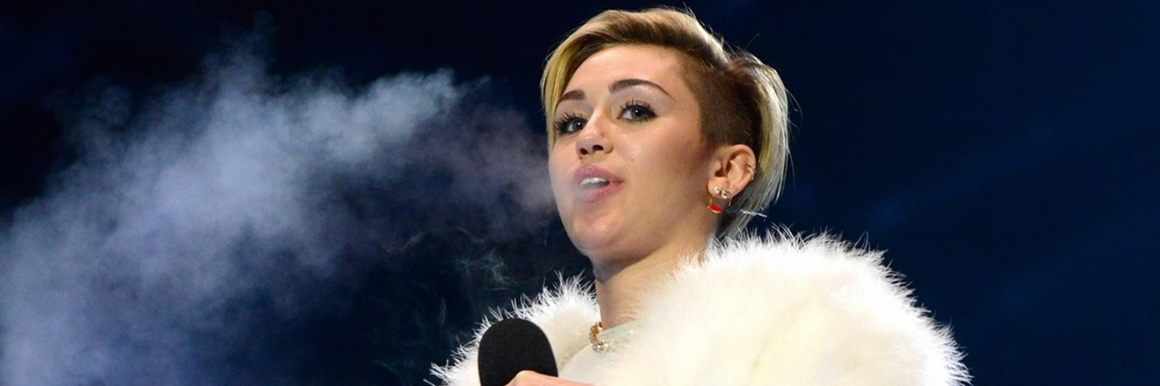 Miley Cyrus Dances with a Dwarf and Smokes a Joint During the MTV EMAs